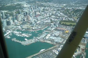 Auckland CBD with Sky Tower and Viaduct Basin2. Jim and LInda. Mar 10